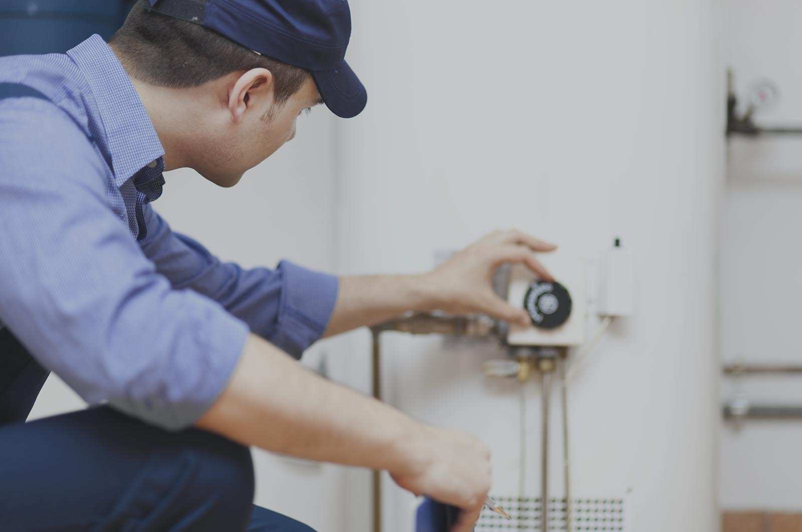 Trained plumber fixing water heater and pumps